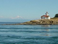 Beautiful Patos Lighthouse Stands Watch With Mount Baker In The Distance