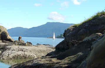 Sucia Island Anchorages Photo With Sailboats And Orcas Island In Background